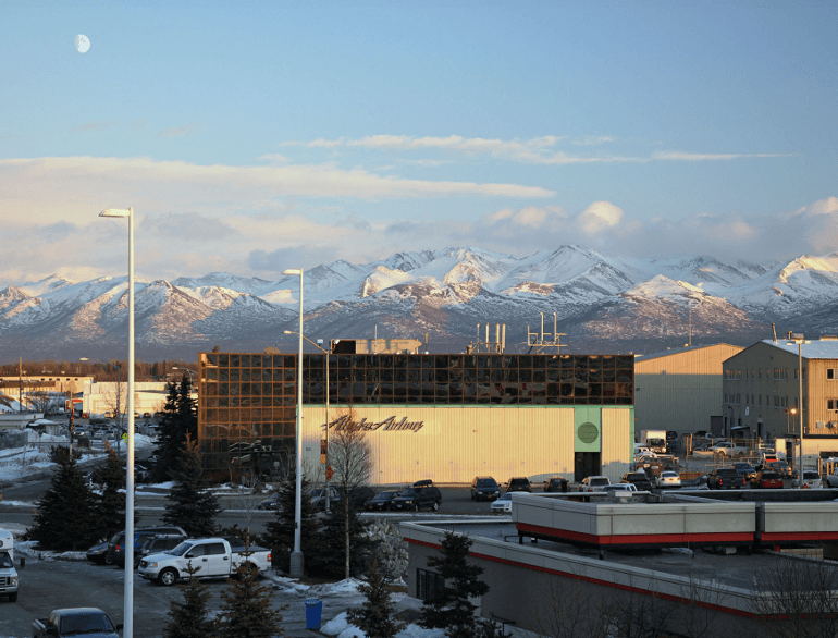 anchorage airport park ride & fly lot logo